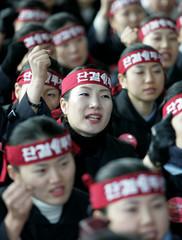 South Korean female train attendants shout slogans at rally at Seoul railway station