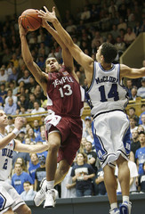 Temple's Tyndale drives to the basket against the defense of Duke University's McClure and McRoberts in Durham
