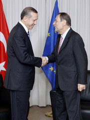 Turkey's PM Erdogan is welcomed by EU foreign policy chief Solana ahead of a meeting in Brussels