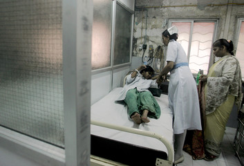 Woman suffering from polio is treated at hospital after she jumped from train in Mumbai