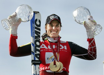Michaela Dorfmeister of Austria shows her women's super-G and downhill World Cup trophys and her Tor..
