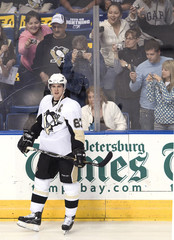 Hockey fans photograph Pittsburgh Penguins center Sidney Crosby during warm ups before a NHL hockey game against theTampa Bay Lightning in Tampa, Florida