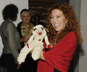 """Mallory Lewis, daughter of the late puppeteer Shari Lewis, holds Lamb Chop at the """"She Made It: Women Creating Television  and Radio"""" salute at the Museum of Television & Radio in Beverly Hills"""