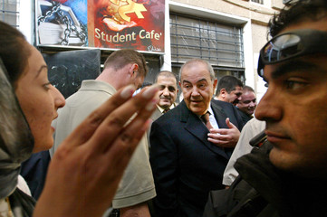 University student speaks to Iraq Prime Minister Allawi during his visit to campus in Baghdad.