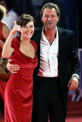 Cast members Houten and Koch react to the crowd at the Cinema Palace in Venice