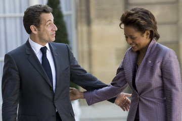 Canada's Governor General Jean is welcomed by France's President Sarkozy at the Elysee Palace in Paris