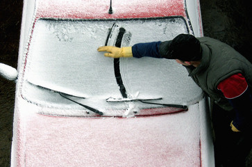 KOSOVO ALBANIAN MAN CLEAN CAR COVERED BY SNOW.