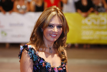 Lebanese actress Carmen Lebbos arrives for the opening ceremony of the 4th edition of the Dubai International Film Festival