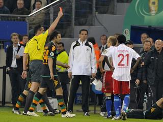Hamburg SV's Jarolim receives a red card from referee Kircher during their German soccer cup (DFB-Pokal) semi-final match against Werder Bremen in Hamburg