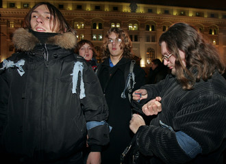Belarussian youth tie jean ribbons to their arms as a symbol of freedom in the capital Minsk