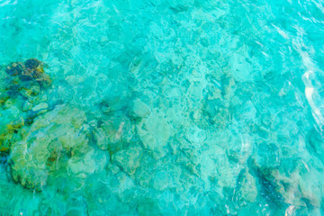 Top view of the sea with the coral reefs at Maldives island .