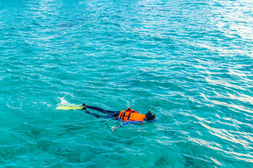 Snorkeling in tropical Maldives island .