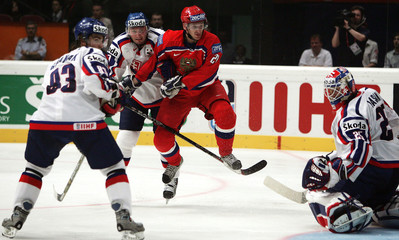 Kharitonov of Russia jumps in front of Lasak of Slovakia during their Group A match at the Ice ...