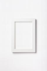 A white photo frame isolated white.