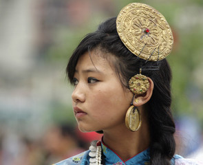 Kirat girl wears traditional ornaments as she takes part in Sakela Ubhauli festival in Kathmandu