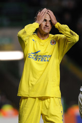 Villarreal's Edmilson reacts following a missed scoring opportunity against Celtic during their Champions League match at Celtic Park