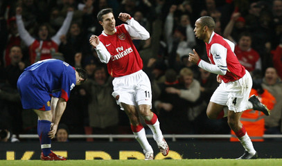 Arsenal's Henry celebrates his goal against Manchester United during their soccer match in London