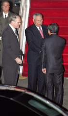 U.S. Secretary of State Powell arrives at a military airport in Seoul.