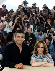 American actor George Clooney (L) and Holly Hunter (R) pose in front of photographers at the 53rd Ca..