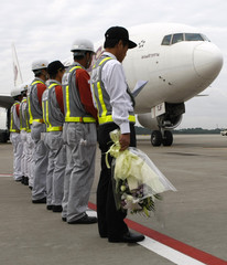 Airport staff wait for the arrival of an airplane from Bangkok carrying coffin containing the body of Japanese video journalist Kenji Nagai, at New Tokyo international airport in Narita