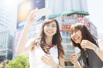 Two young ladies are shooting at Shibuya