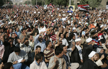 Demonstrators chant slogans during a rally at al-Firdos square in Baghdad