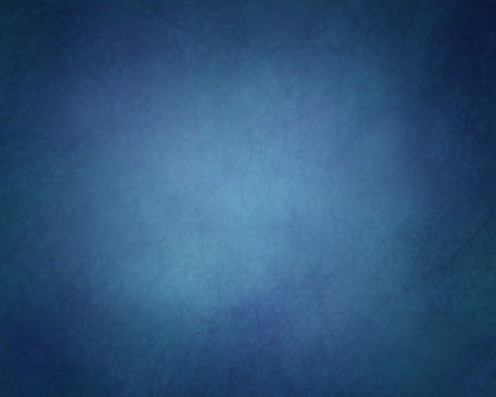 abstract solid background in dark blue color hues with soft lighting and vintage grunge textured vignette border