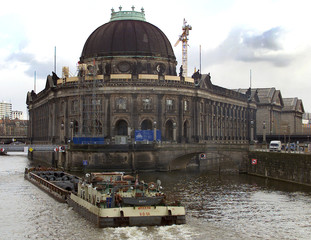 A barge passes by the Bode Museum on the Museumsinsel (Museum Island) in the old inner city center o..