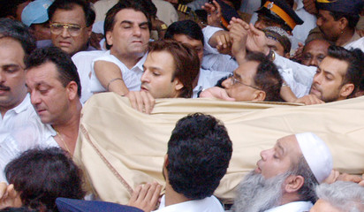 Bollywood star Sanjay Dutt carries the body of his father former bollywood icon Sunil Dutt in Bombay.