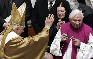 Pope Benedict XVI passes his brother, Georg Ratzinger (R), in his popemobile after his inaugural Mas..