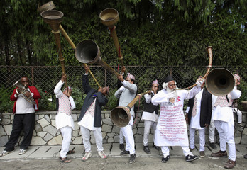 Supporters of former Nepalese king Gyanendra play traditional music instruments to wish him a happy birthday, at his private residence in Kathmandu