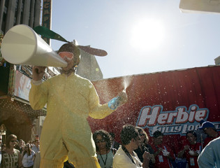 "An attendant sprays water to refresh guests at the World Premiere of ""Herbie - Fully Loaded"" after ..."