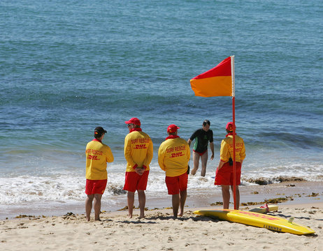 Lifesavers watch a solitary swimmer leave the water at North Cronulla Beach in Sydney