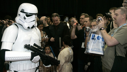 Fans take photos of a Stormtrooper during the Star Wars Celebration Europe exhibition at the Excel Centre in London