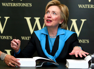 """HILLARY RODHAM CLINTON SIGNS COPIES OF HER NEW BOOK """"LIVING HISTORY"""" INWATERSTONES BOOK SHOP IN LONDON."""