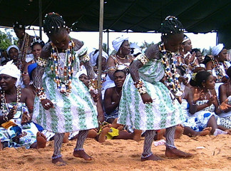 Two girls perform a traditional voodoo dance in the West African capital of Cotonou, Benin.
