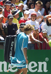 GUSTAVO KUERTON FROM BRAZIL WALKS OFF COURT AFTER LOSING HIS SECONDROUND MATCH AT THE AUSTRALIAN ...