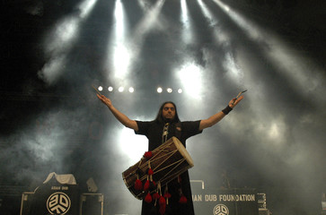 A member of the band Asian Dub Foundation performs at WOMAD Singapore