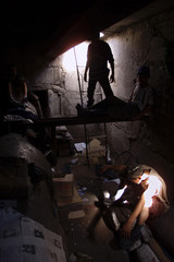Ulan Bator streetkids rest in their underground shelter July 4. Children from impoverished families ..