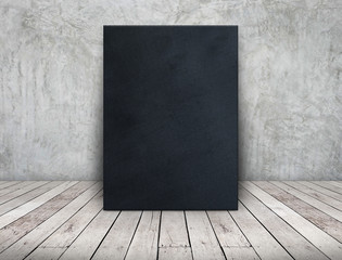 Blank long black fabric canvas frame leaning at concrete wall on wooden plank floor in perspective room,Business mock up presentation design