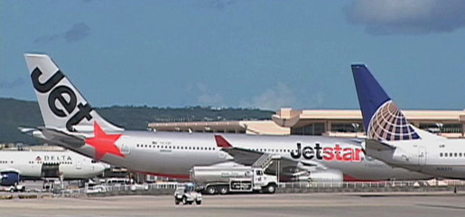 Video grab of Jetstar aircraft sitting on the tarmac of Guam airport