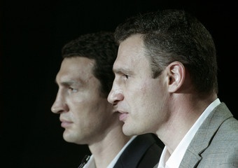 Ukrainian boxers Klitschko with his brother speak during their news conference in Kiev