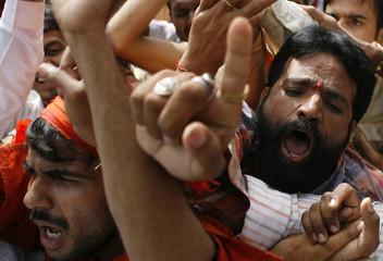 Activists of Vishwa Hindu Parishad shout during a protest over a land row in Mumbai