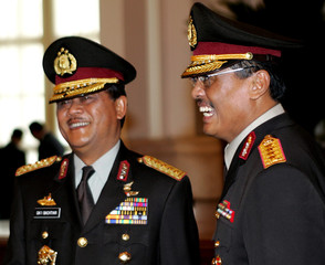 Indonesia's new police chief General Sutanto smiles after a swearing in ceremony at the ...