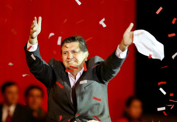 Peruvian presidential candidate Alan Garcia waves to supporters during his final campaign rally in Lima