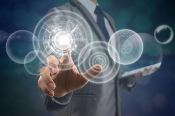 Businessman pointing the modern virtual screen over the photo blurred background, business and technology concept