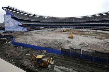 The shell of Shea Stadium, the former home of the Mets, is all that is left as it is being demolished in New York