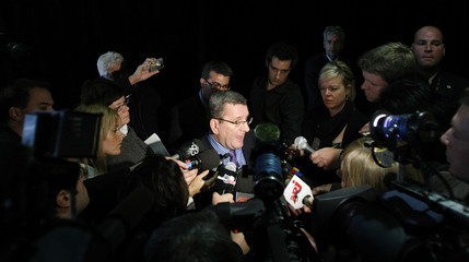 Quebec City mayor Regis Labeaume (C) speaks to journalists after a news conference at the Colisee in Quebec City