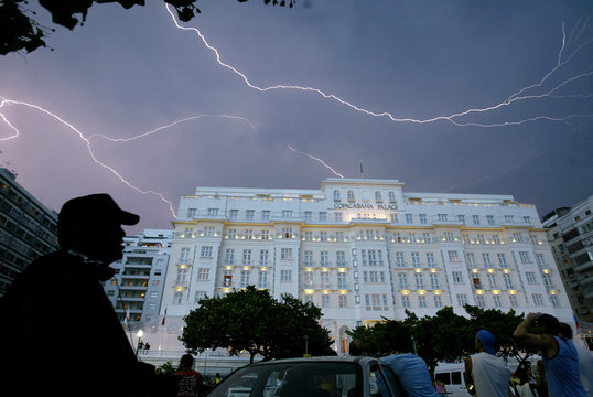 Lightning flashes above the hotel where the Rolling Stones are staying at Copacabana beach in Rio de Janeiro