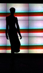 A MODEL IS SILHOUETTED DURING FASHION SHOW FOR 'FORESTS FOR THE WORLD' IN LONDON.